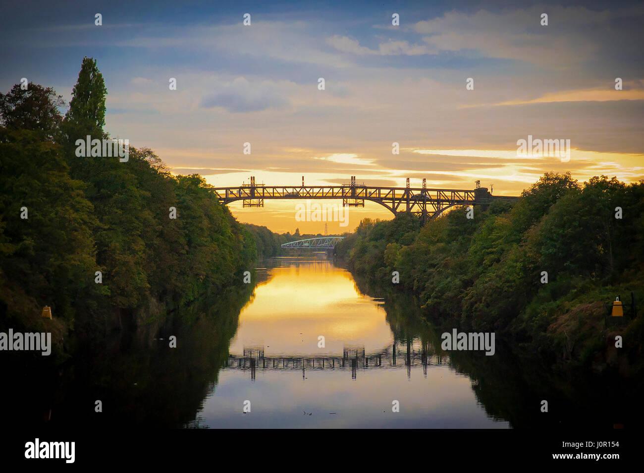 Manchester ship canal. Warrington cantilever bridge sunset - Stock Image