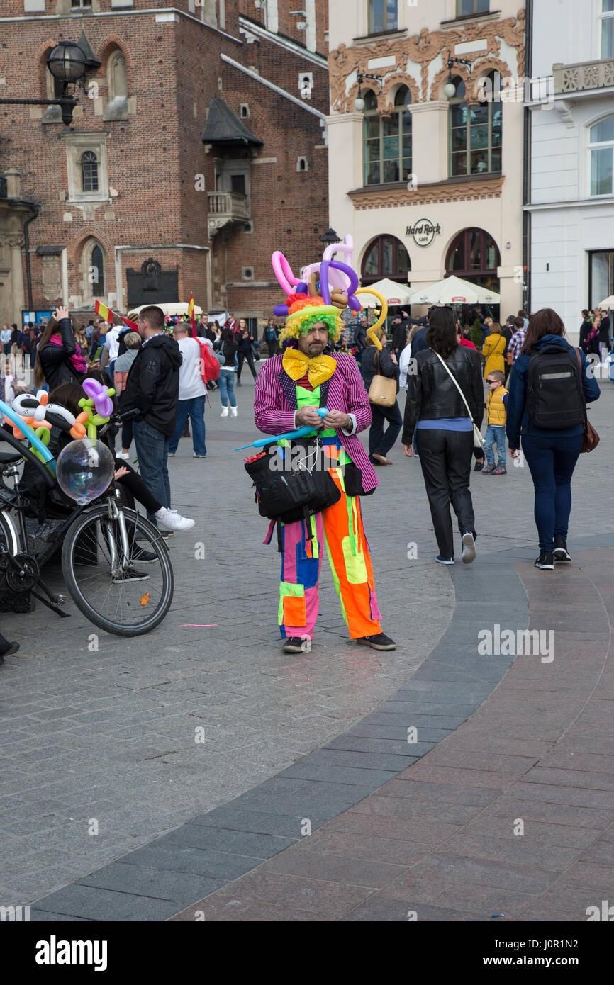 Balloon modeller in Krakow market square - Stock Image