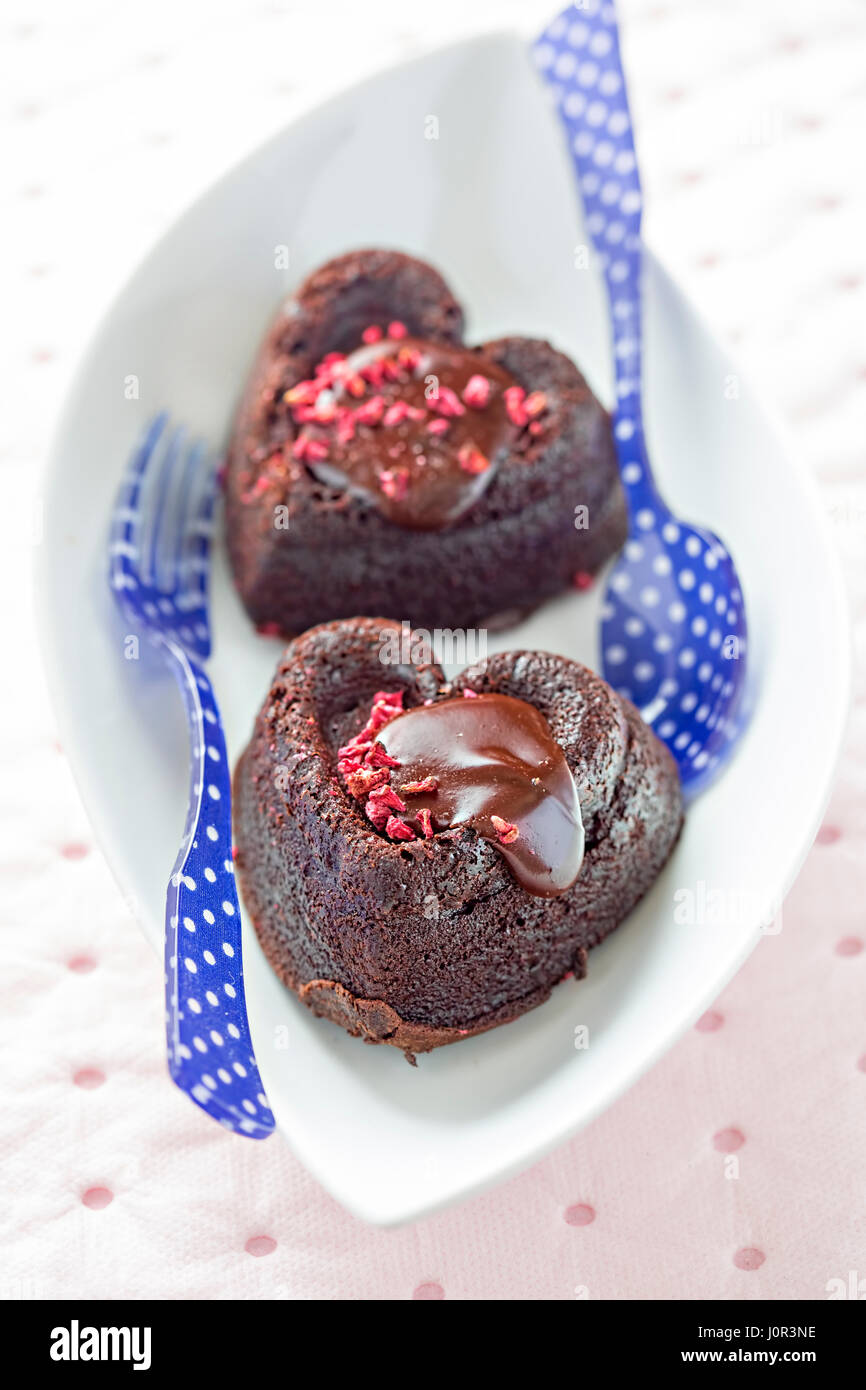 Heart shaped brownies with dried strawberries - Stock Image