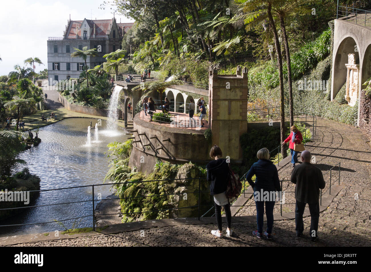 Tourists walking down towards 'Swan Lake' in Nonte Palace Tropical Garden, Funchal, Madeira - Stock Image