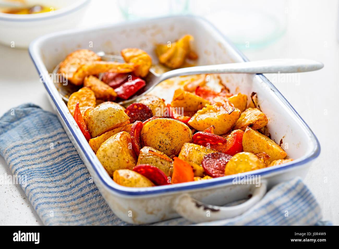 Chorizo, potato, red pepper onion tray bake Stock Photo