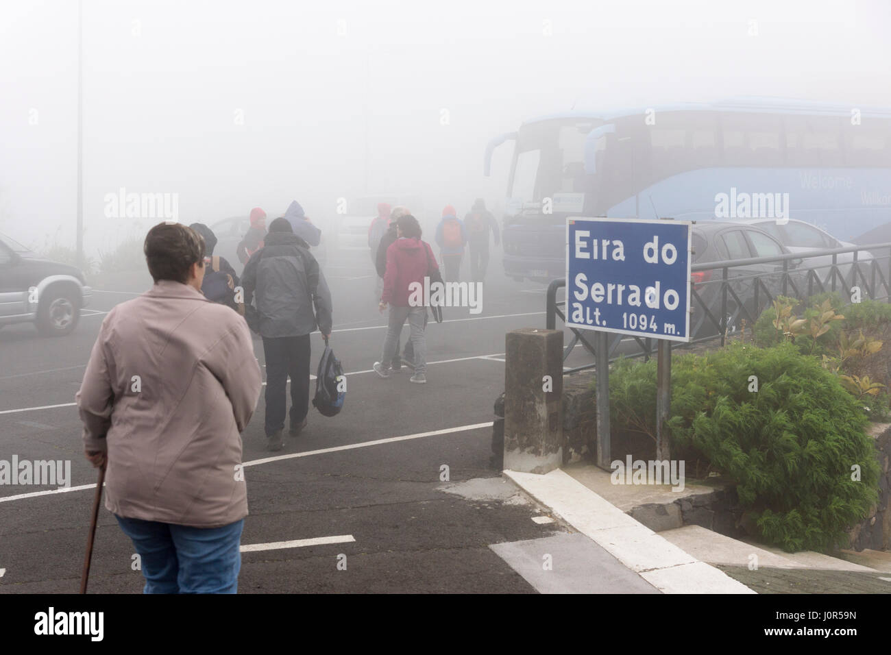 Low visibility from mist and rain on New Year's Eve at Eira do Serrado viewpoint, Madeira - Stock Image
