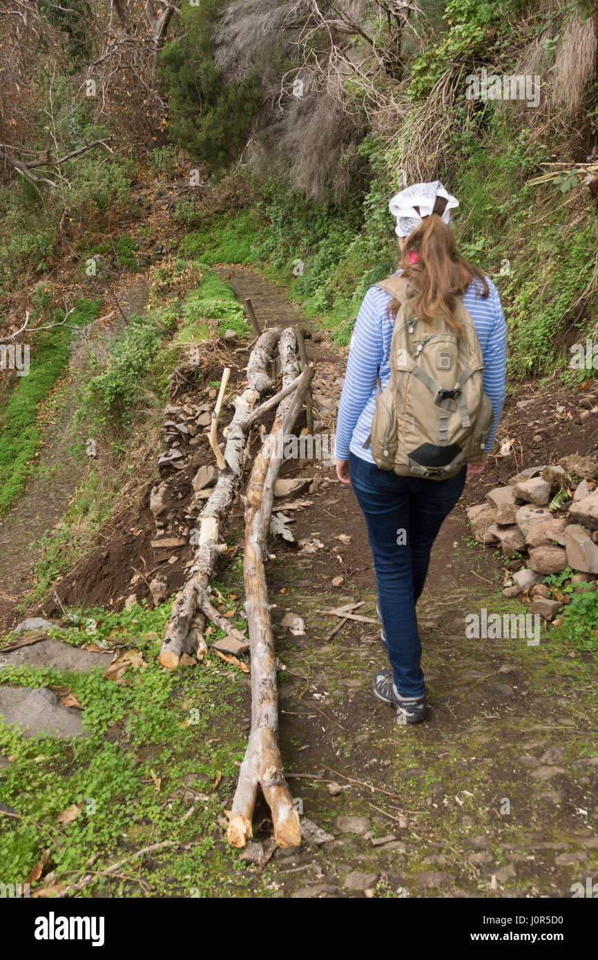 A tourist making their way down the footpath to the Curral das Freiras - Stock Image