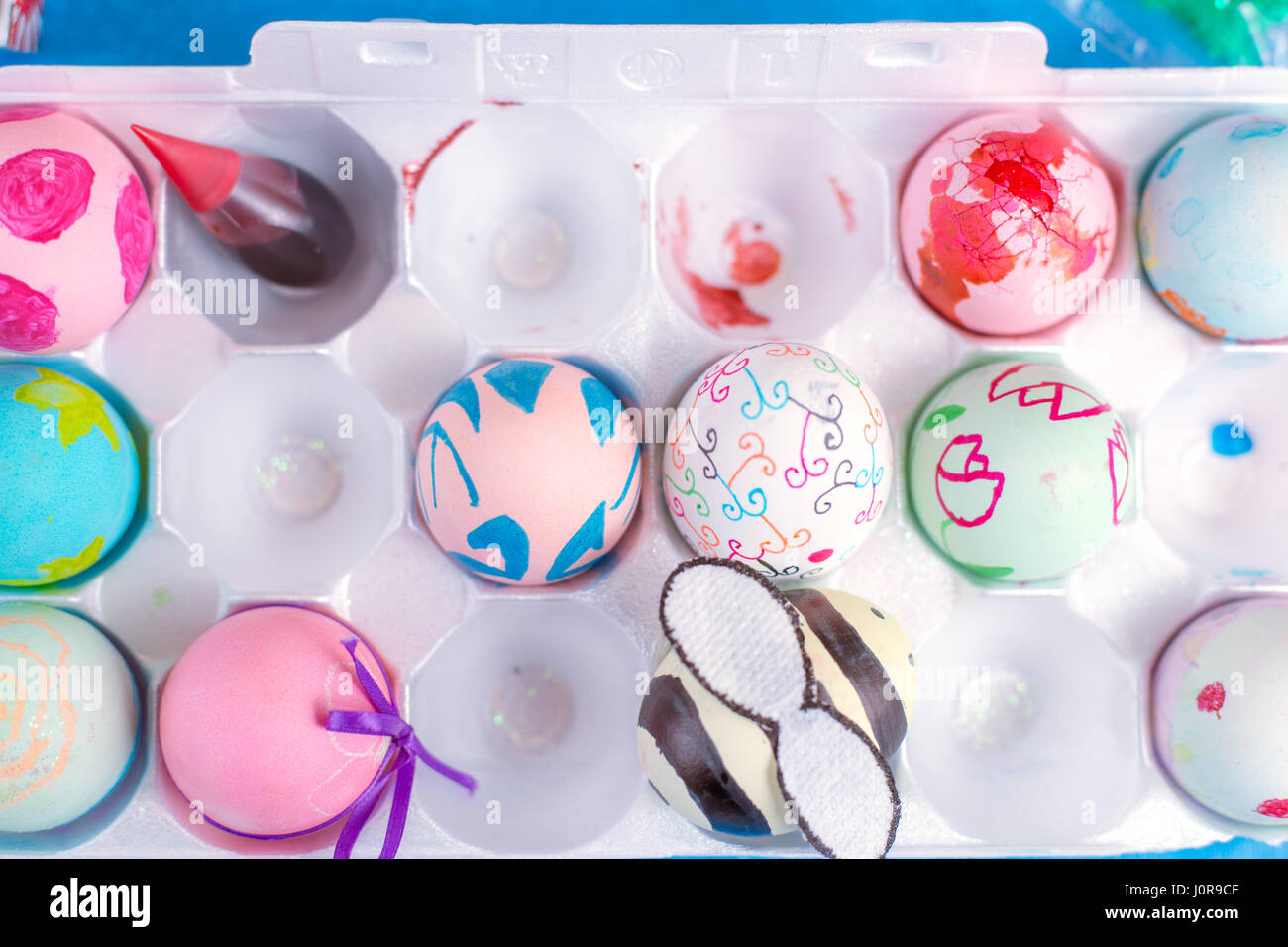VARIETY OF DIFFERENT COLOUR EASTER EGGS AND EASTER EGG MAKING TOOLS Stock Photo