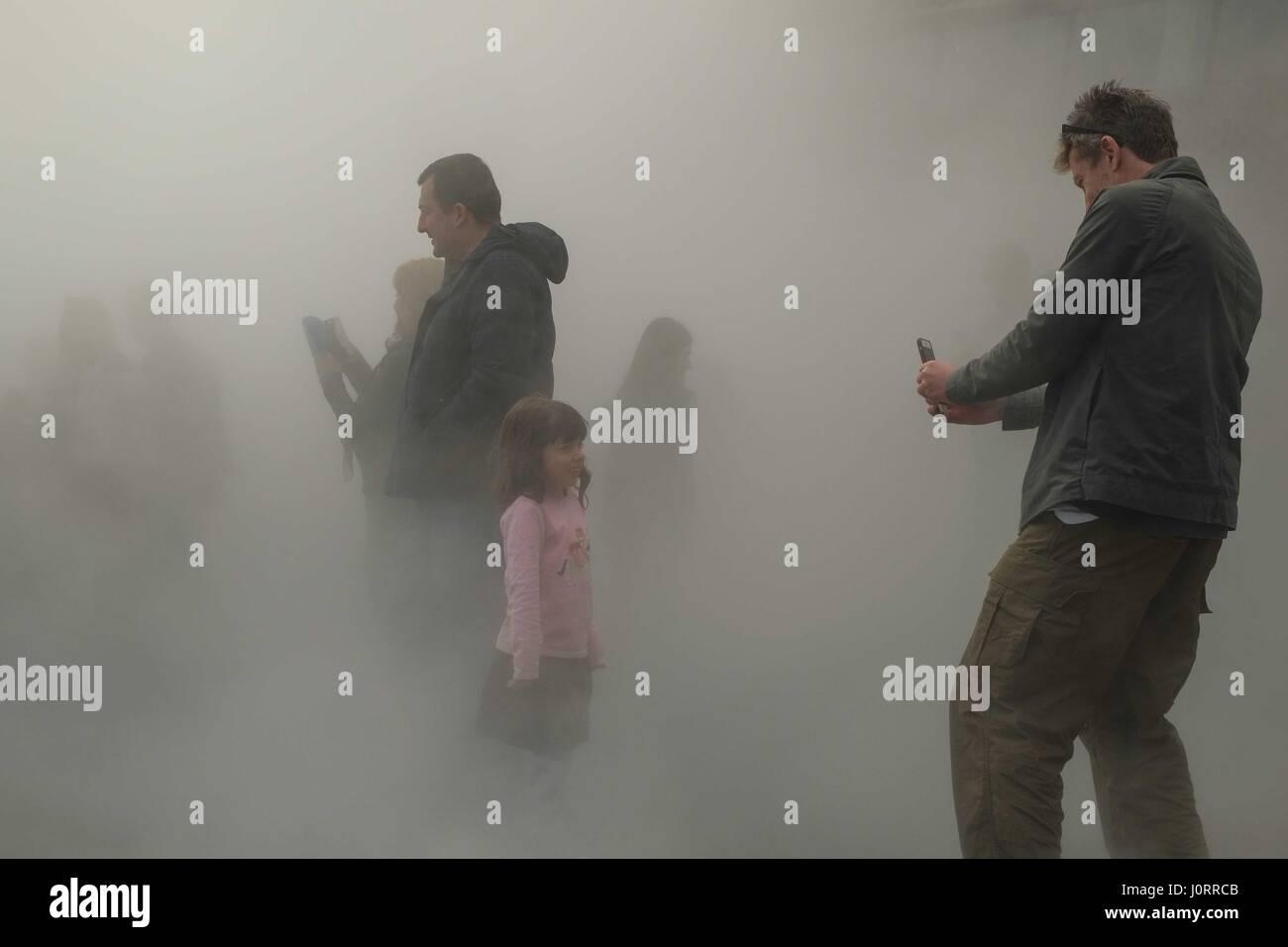 London, UK. 15th April 2017. Visitors continue to explore  Fujiko Nakaya's fog sculpture outside Tate Modern's Switch Stock Photo