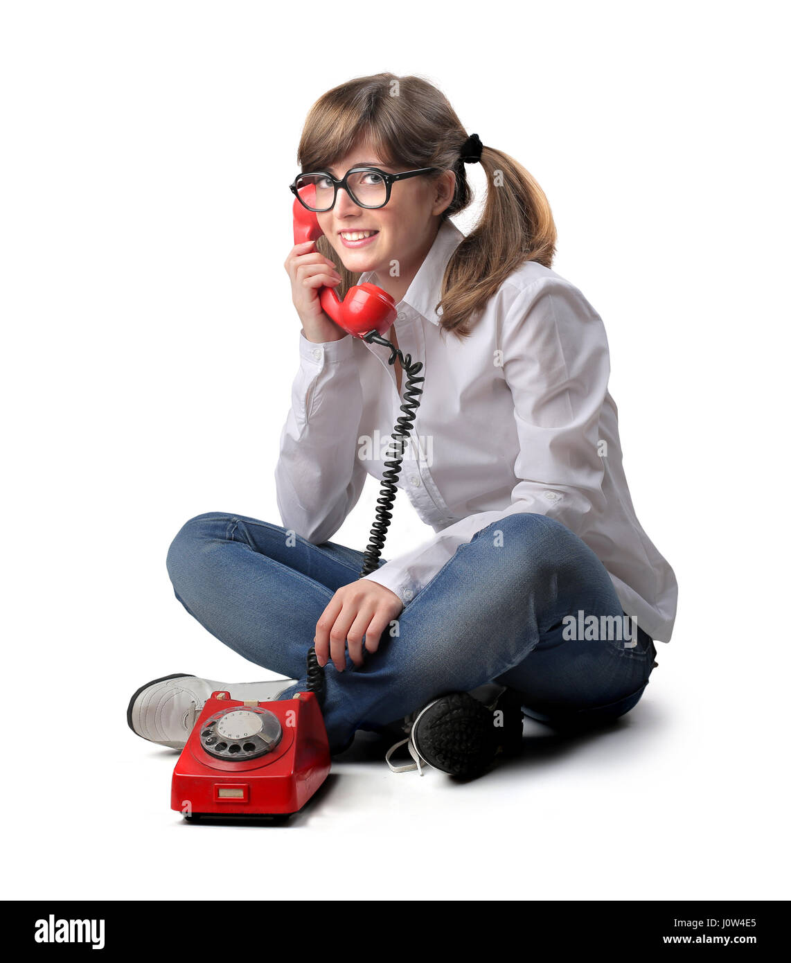 Woman talking with red retro phone - Stock Image