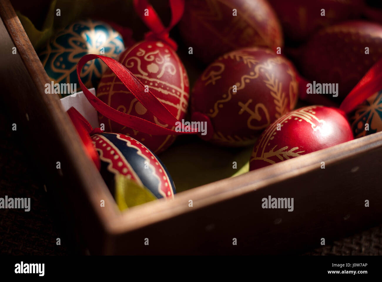 colorful handmade Easter eggs in wooden box Stock Photo