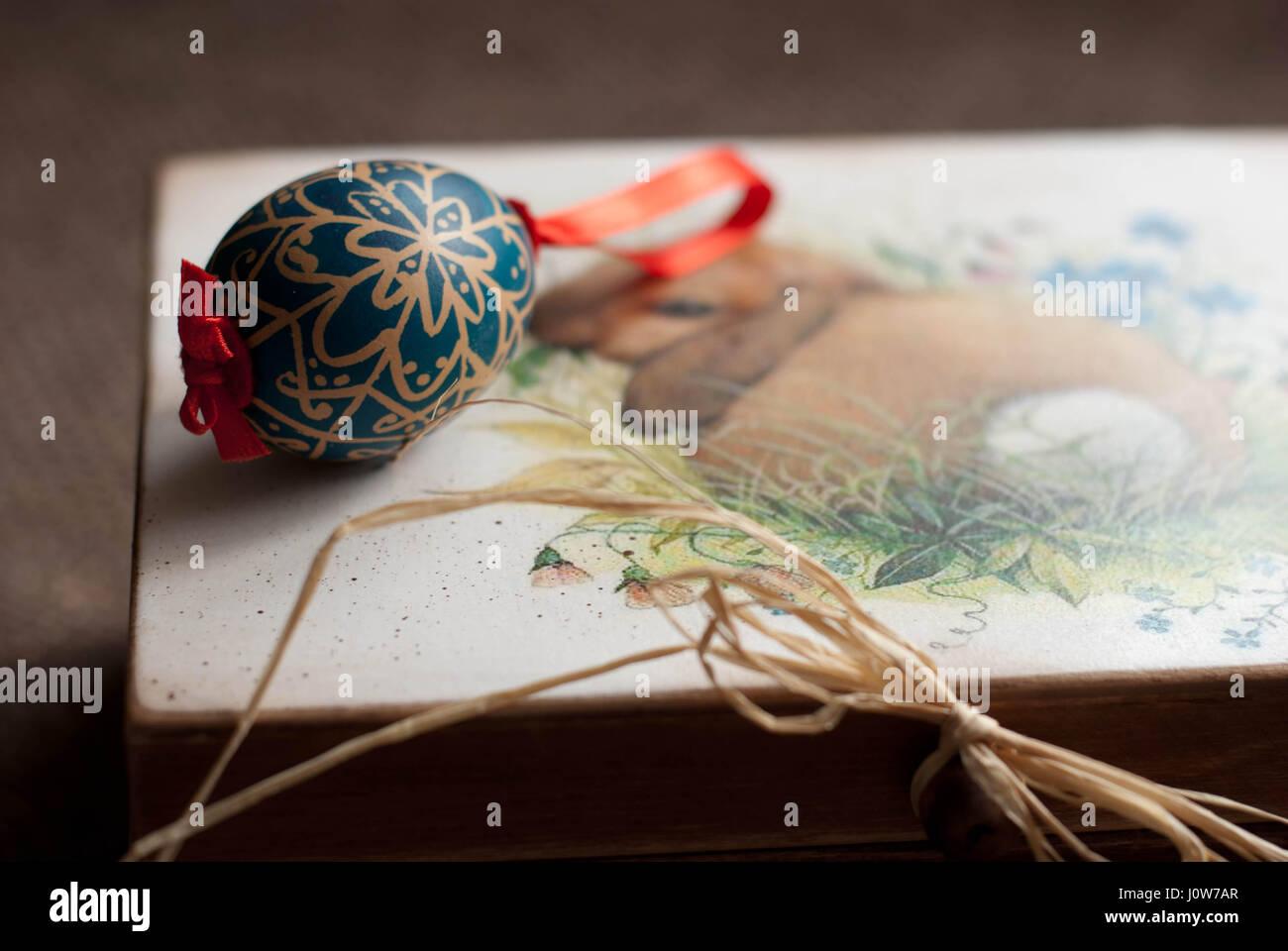 blue handmade Easter egg on rabbit pattern wooden box Stock Photo