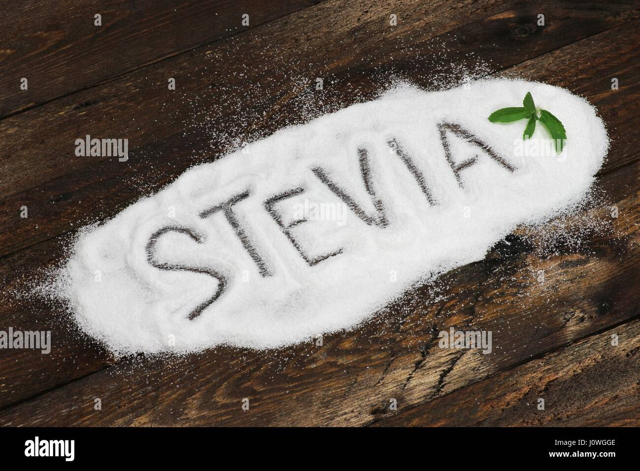 STEVIA written in stevia powder on wooden background - Stock Image