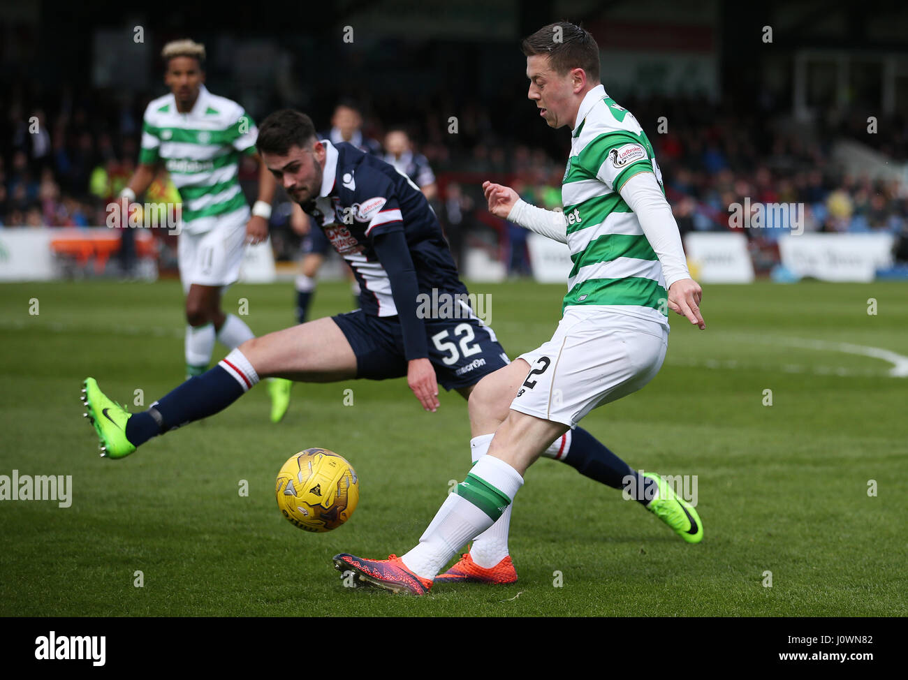 Ross County's Reghan Tumility and Celtic's Callum McGregor battle for the ball during the Ladbrokes Scottish - Stock Image