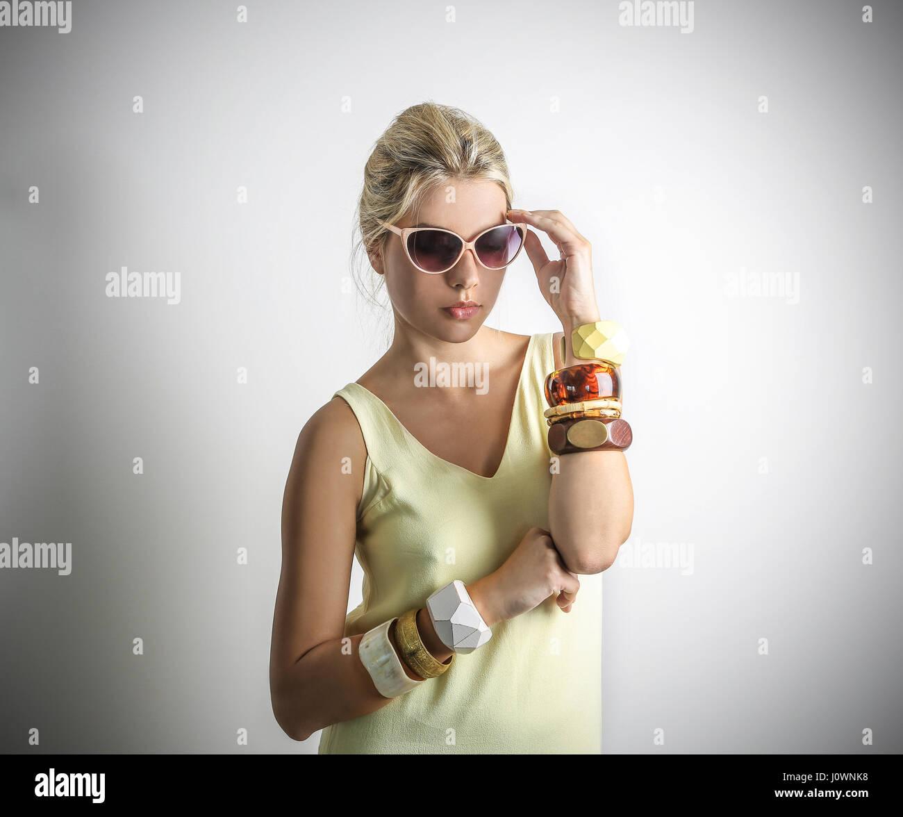 Blond woman with bracelets - Stock Image