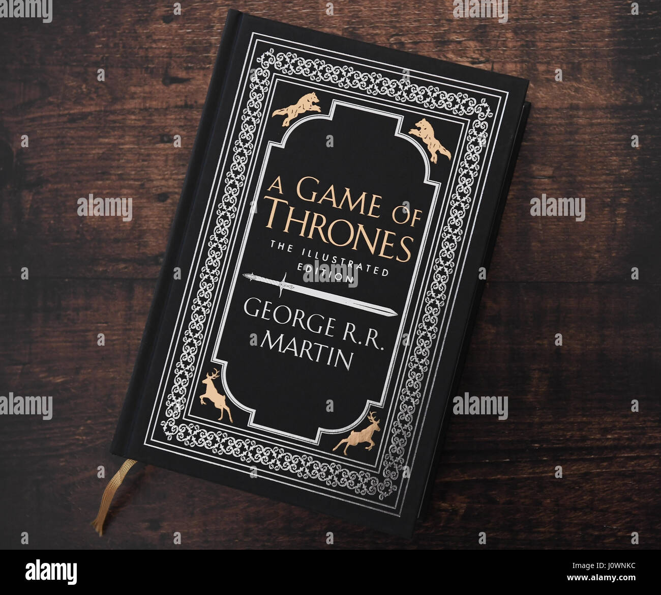 A Game of Thrones book one a wooden table, from the series a
