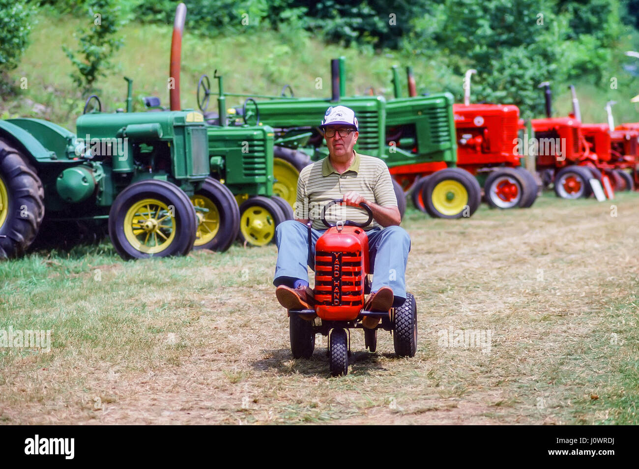 Guy On Tractor : Men driving tractors stock photos