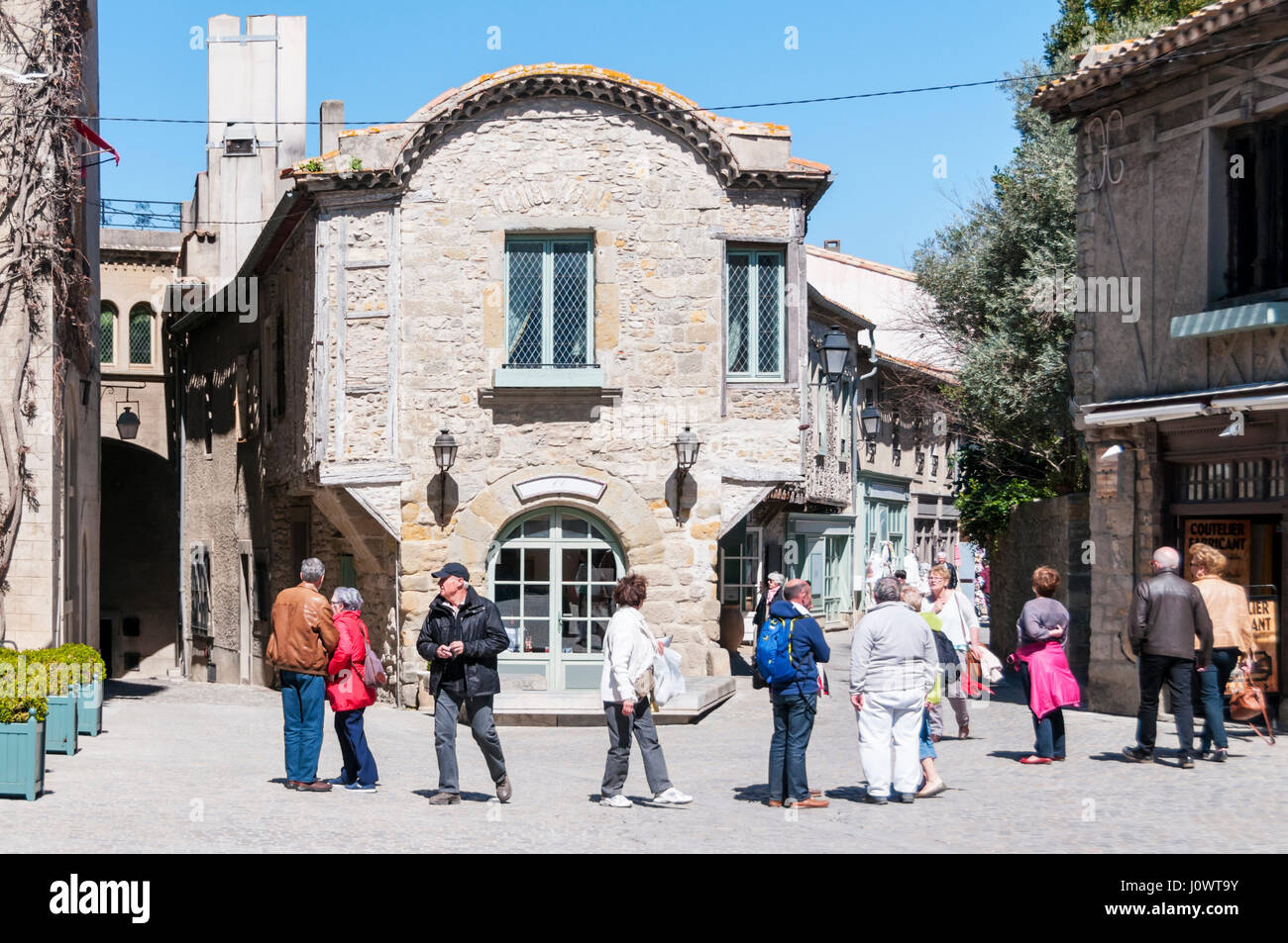 Visitors explore the narrow streets of the old Cite of Carcassonne in le Midi,southern France, restored by Eugène - Stock Image