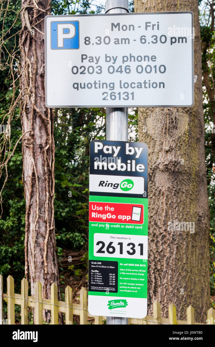 A sign for on-street parking giving details to allow payment of parking fees by mobile 'phone using the RingGo - Stock Image