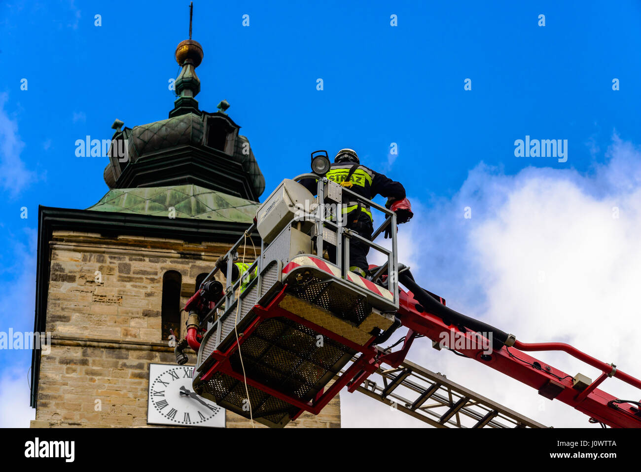 Firebrigade on high altitude action. - Stock Image