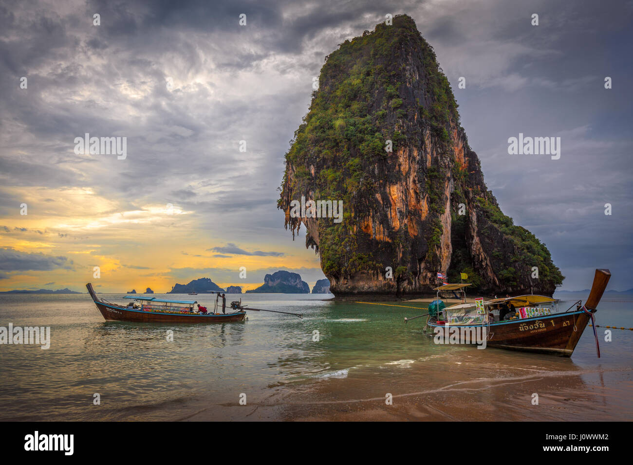 Phra Nang beach, Railay, Krabi province, Thailand: longtail food vendor boats in front of Happy Island - Stock Image