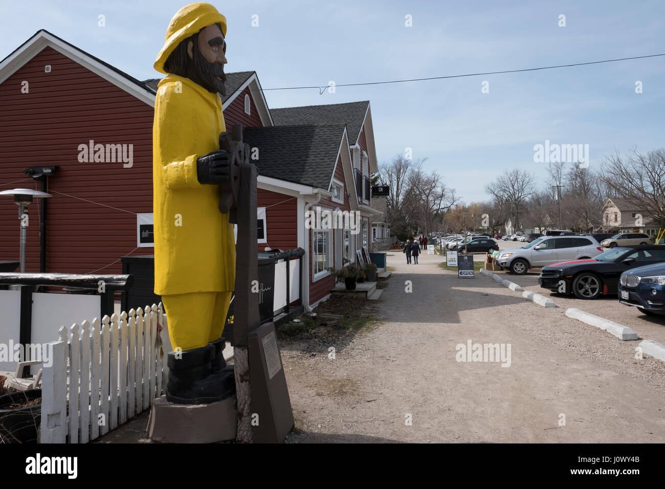 Captain Harry, a wood carving of a sailor, stands as the watchman of Main Street in the Village of Bayfield, Ontario, Stock Photo
