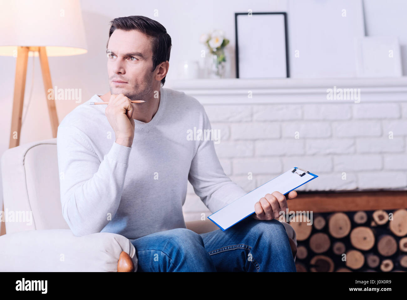 Pleasant serious man thinking about something - Stock Image