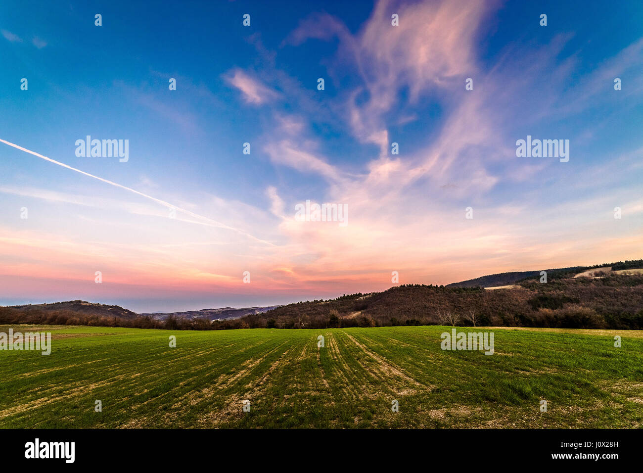 Rural landscape at sunset, Tramonto, Italy - Stock Image