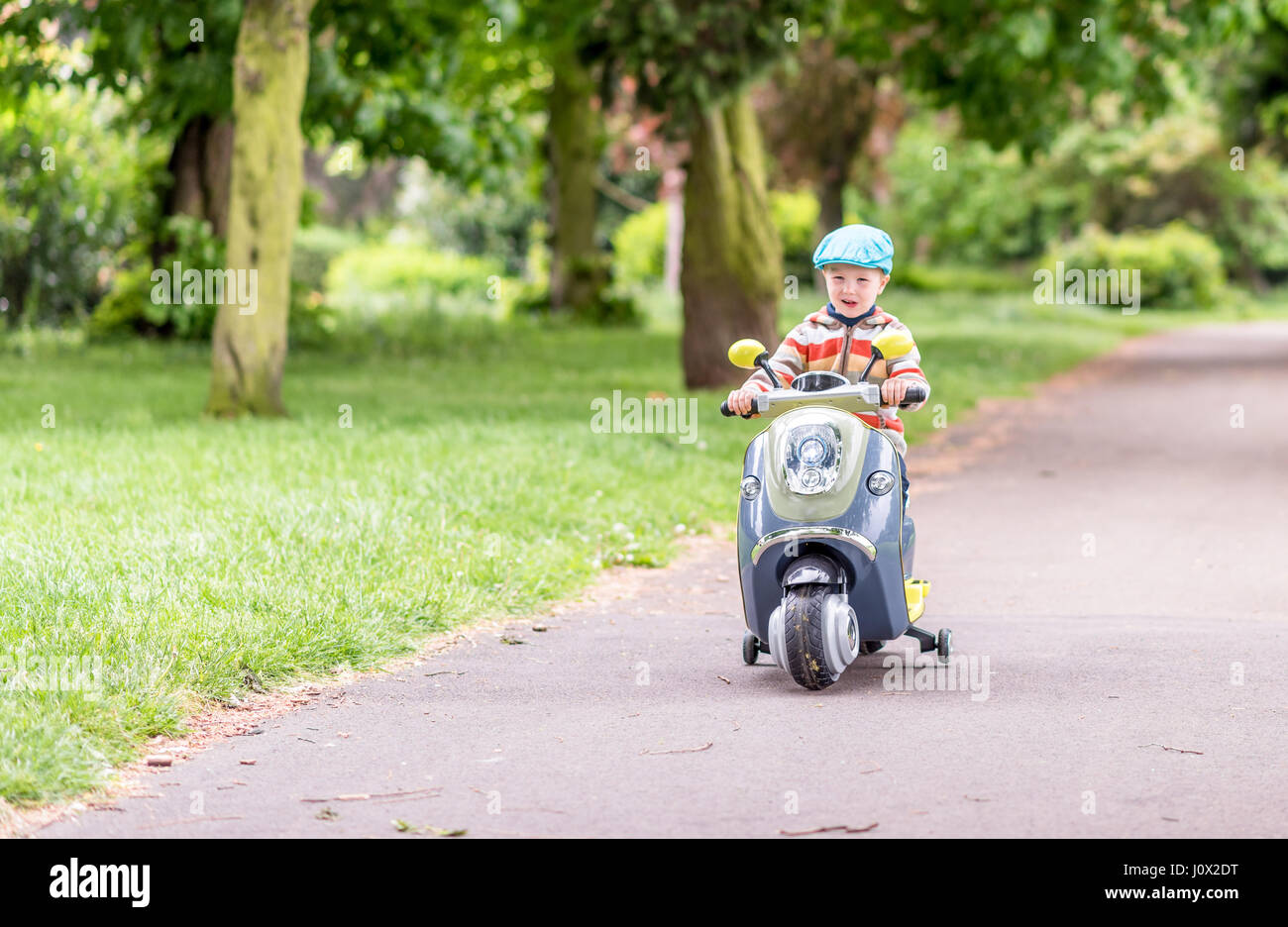 Day View Child Boy Riding Scooter Summer Park Stock Photo 138255652