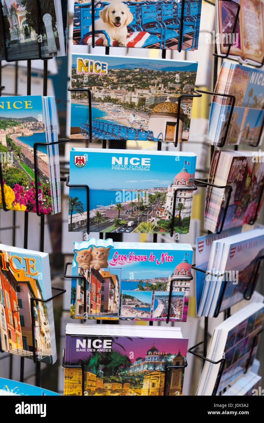 France, Nice, tourist postcards for sale. - Stock Image