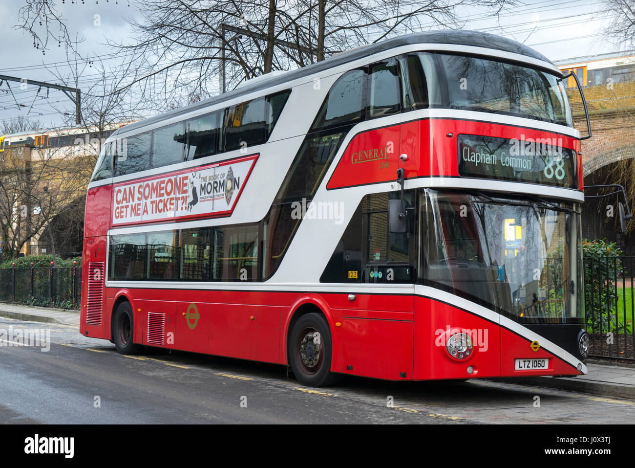 A moden new Routemaster bus painted in the colours of the original London General Bus Company founded in 1855 operating - Stock Image