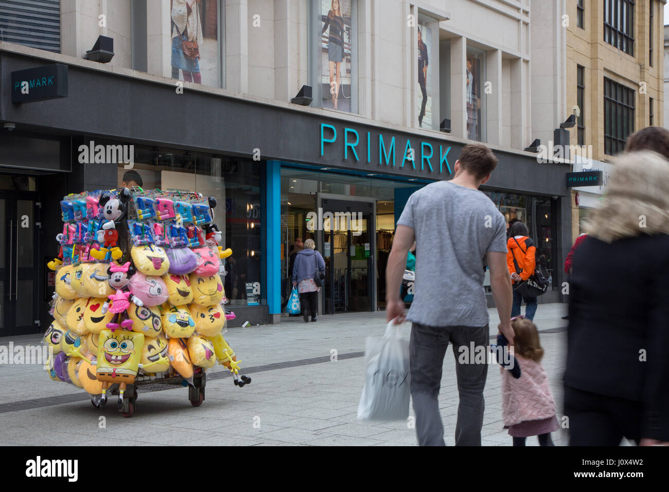 Primark on Queen Street, Cardiff. Vendors in the foreground are selling emoji cushions etc. - Stock Image