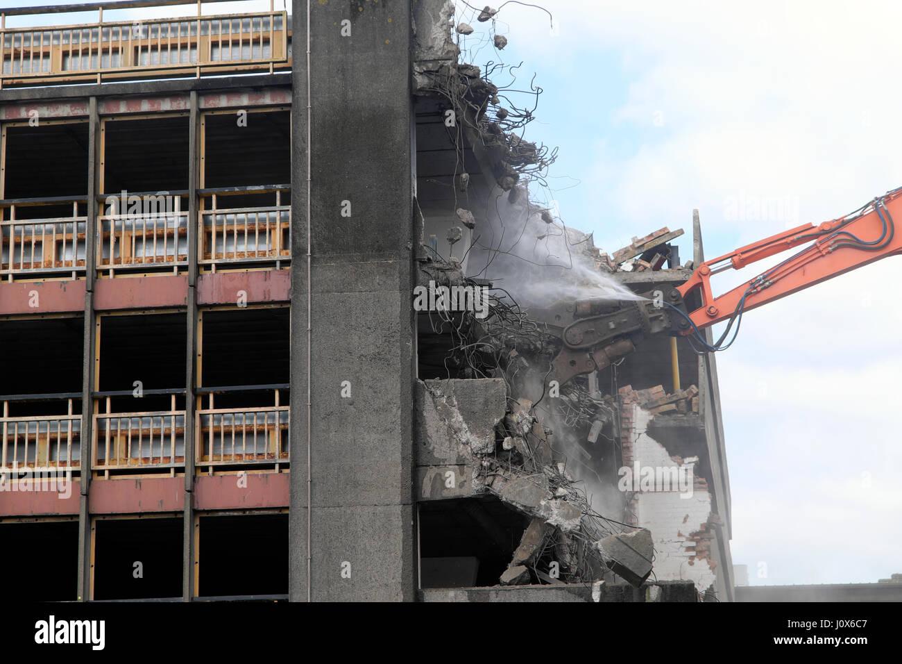 Spec excavator demolition of derelict buildings on construction site Wood St car park near Central Square, Cardiff Stock Photo