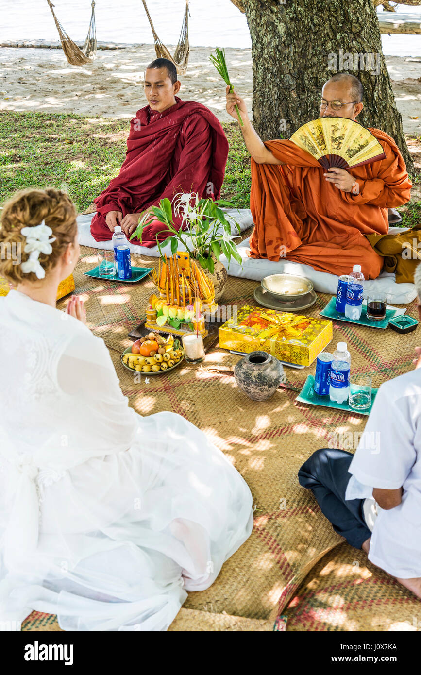 monks blessing buddhist wedding ceremony for western european couple in cambodia asia - Stock Image