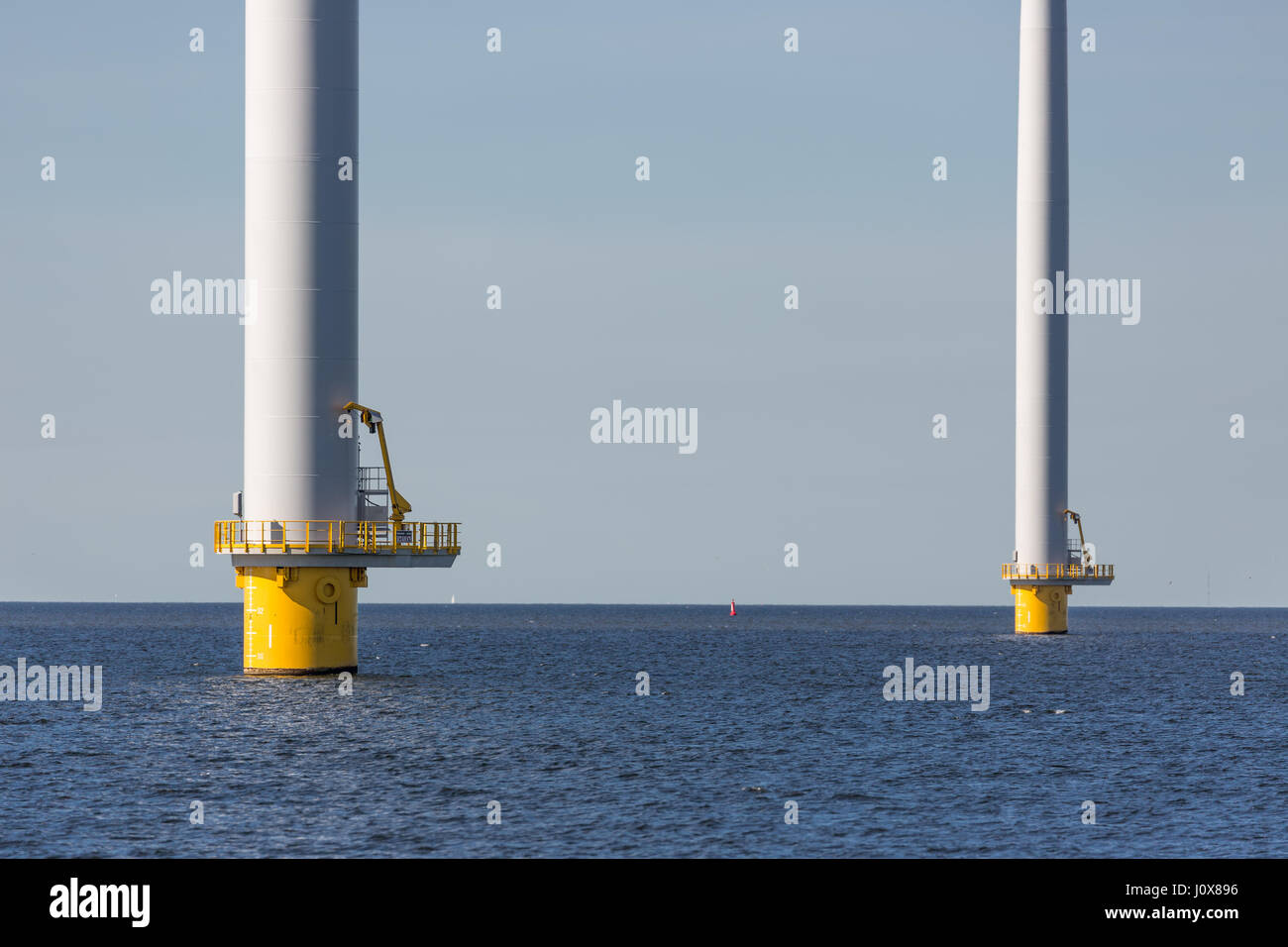 Foundation of big wind turbines standing in the sea Stock Photo