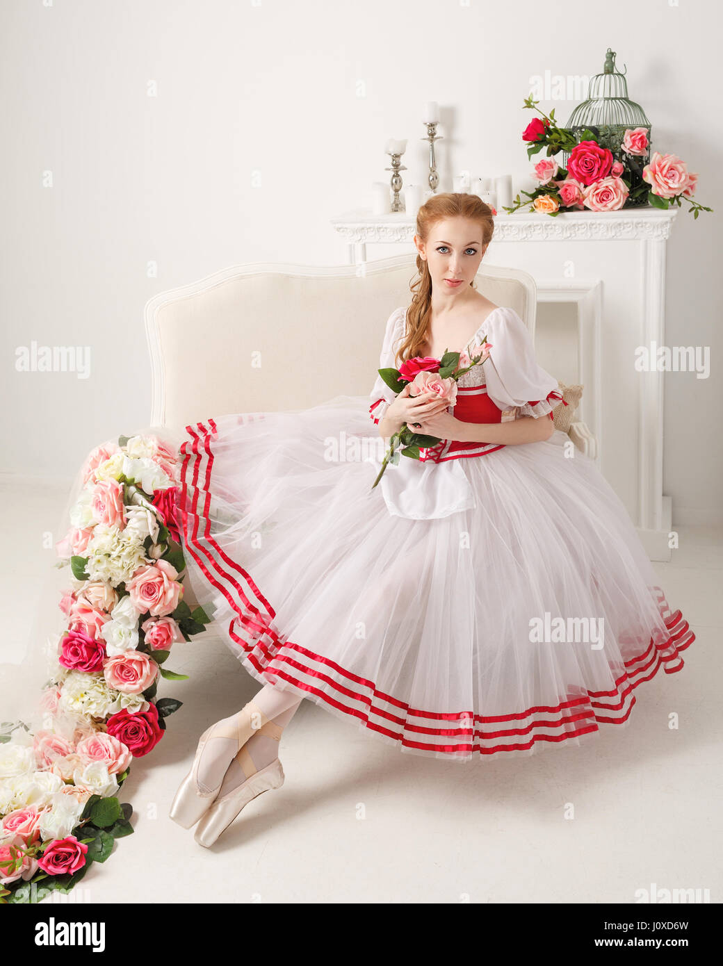 Pretty ballerina in stage costume, holding a bouquet of spring Stock ...
