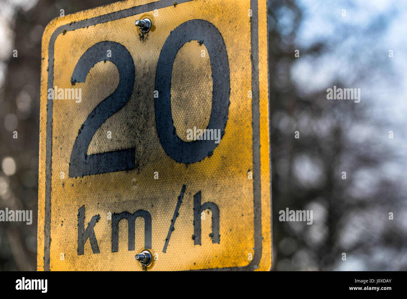 A closeup of 20km/h sign found on a street. Stock Photo