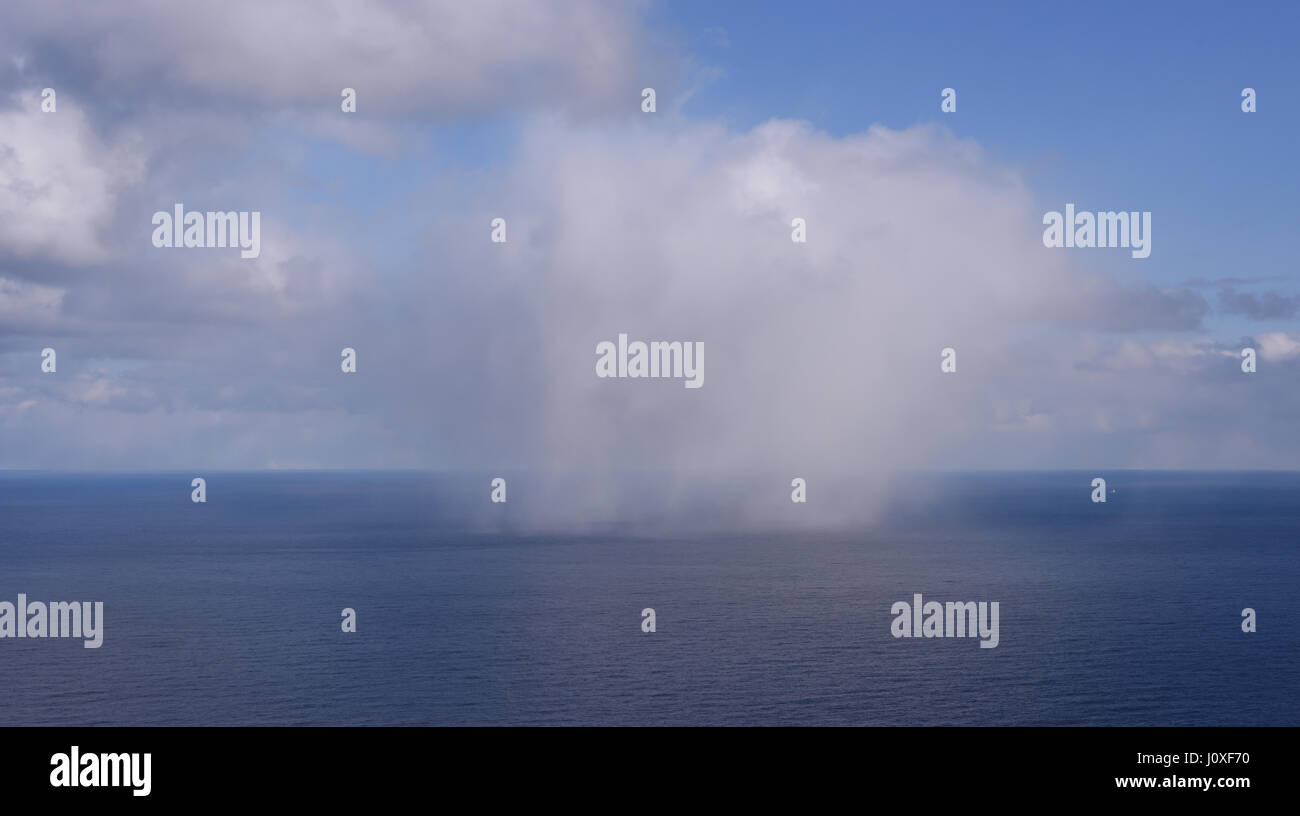 A squall or snow flurry blows across the Barents Sea off North Cape. Nordkapp, Finmark, Norway. - Stock Image