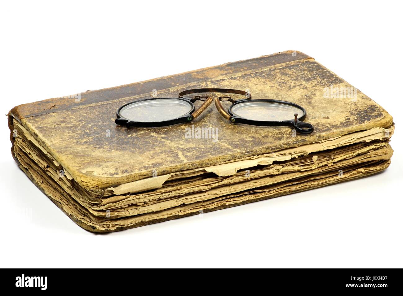 antique book with pince-nez isolated on white background Stock Photo
