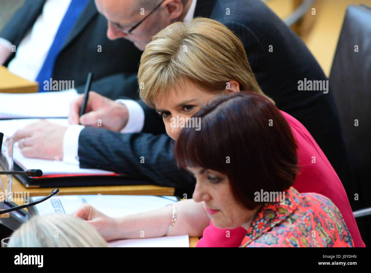 Scotland's First Minister Nicola Sturgeon (C) during the debate on the Scottish Government's legislative - Stock Image