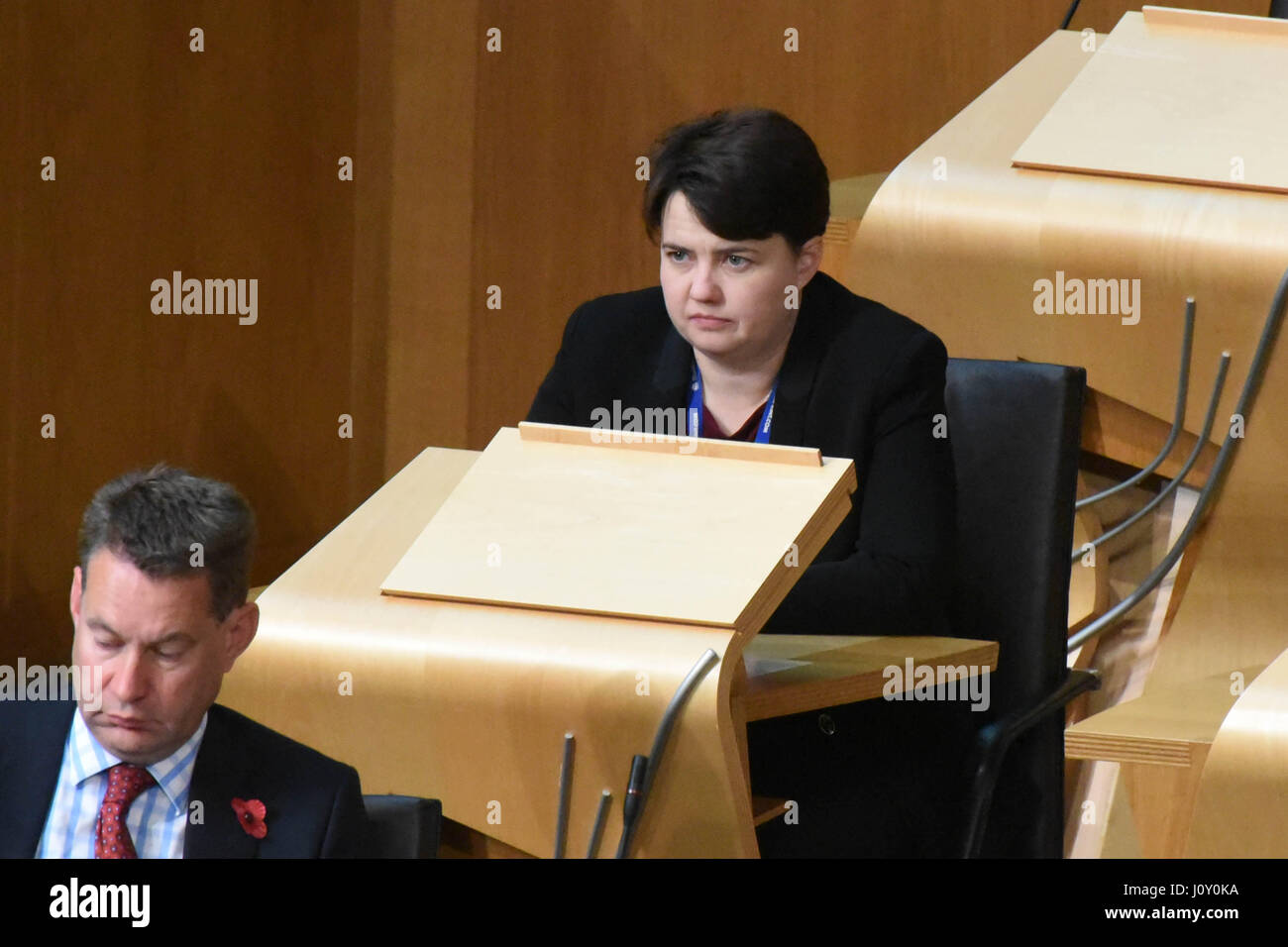 Scottish Conservative leader Ruth Davidson takes a seat on the backbenches during the debate on Trident renewal in the Scottish Parliament Stock Photo