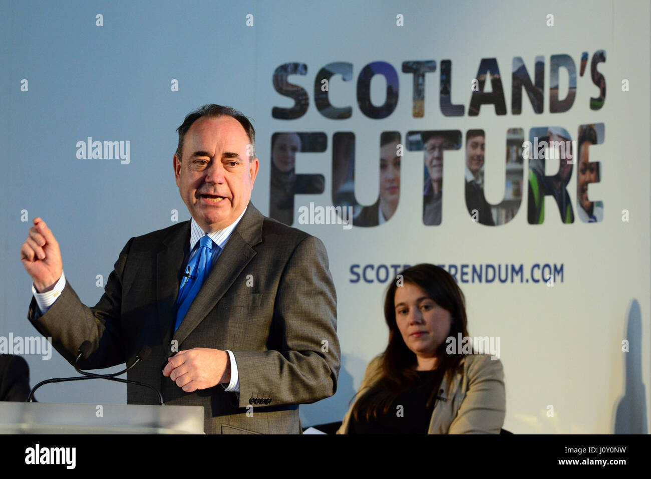 Scotland's First Minister Alex Salmond addresses a public meeting in Arbroath as Cabinet colleagues look on - Stock Image