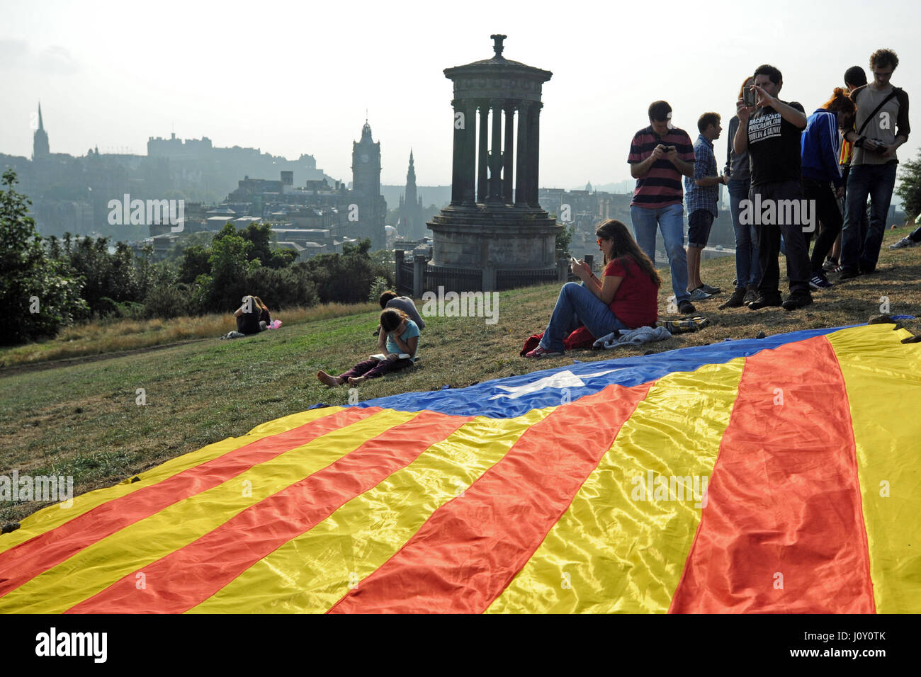 Catalonian nationalists living in Scotland promote Catalonian indpendence with a march from the Scottish Parliament - Stock Image