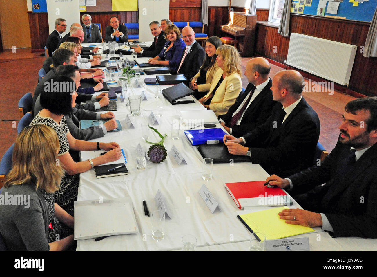 Scotland's First Minister Alex Salmond (at head of table, R) hosts a full Cabinet meeting in a church hall in - Stock Image