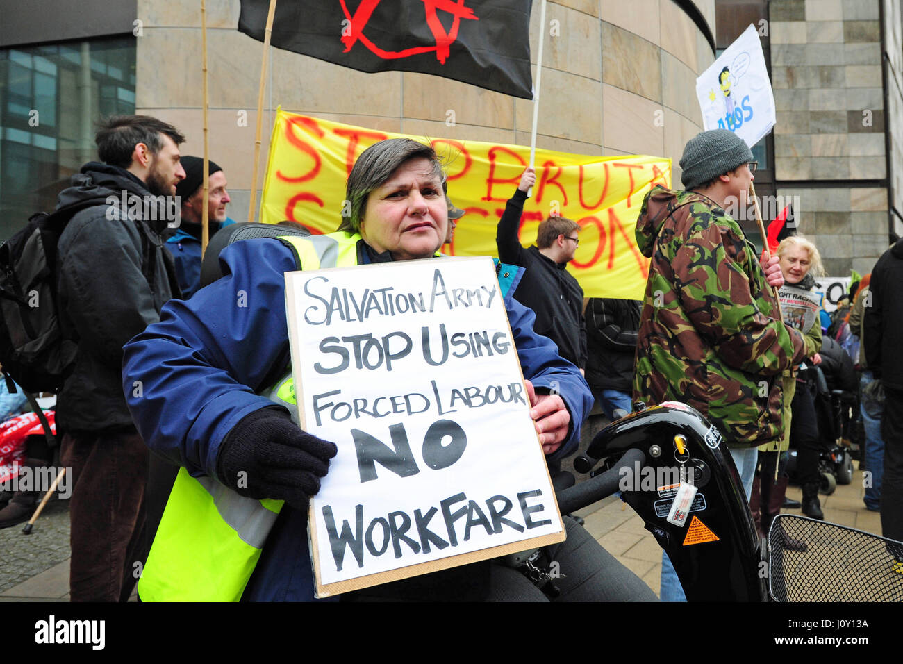 One of a group of about 50 demonstrators carries a placard outside the Scottish Conservative Party conference in - Stock Image