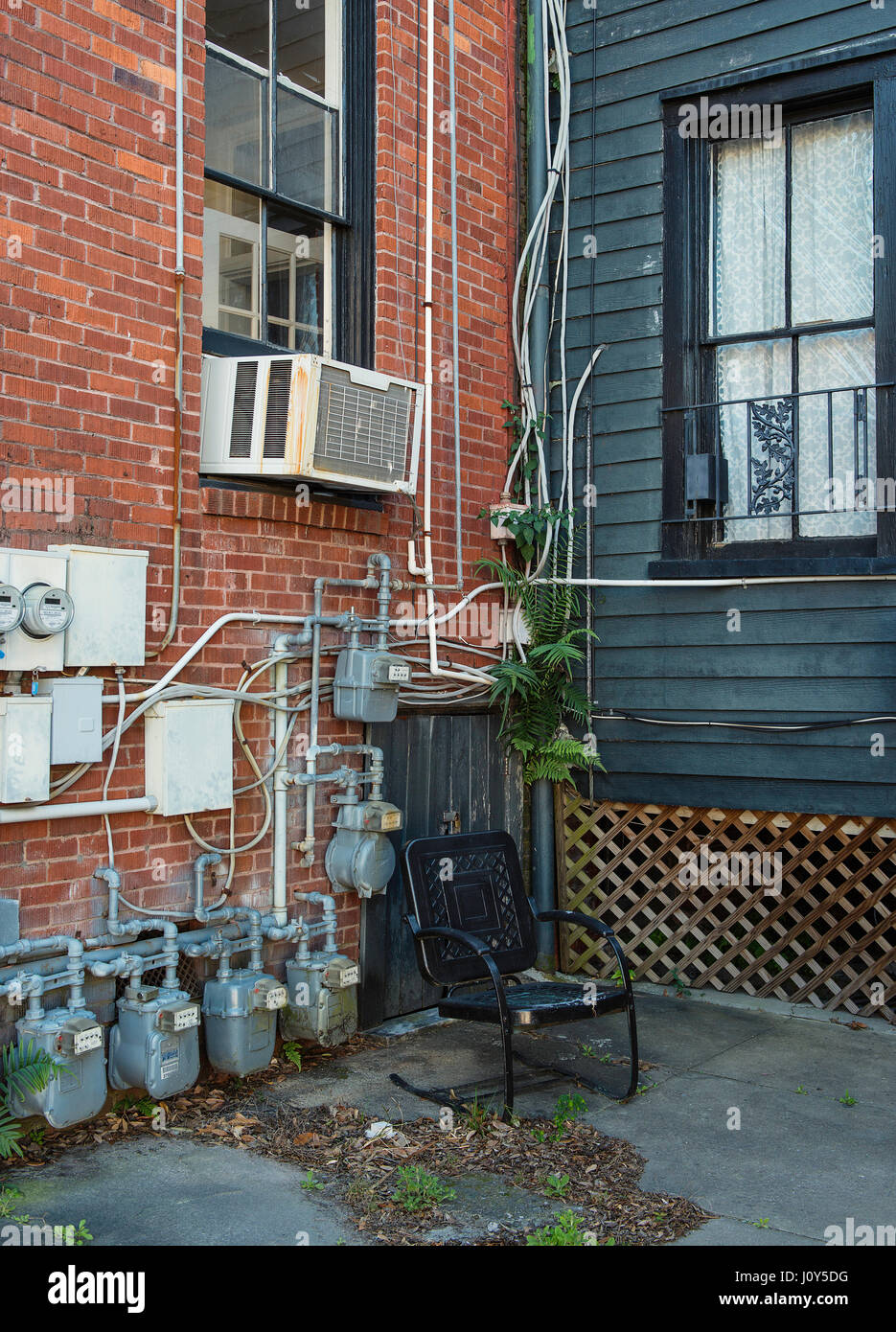 A chair next to some gas meter readers. - Stock Image
