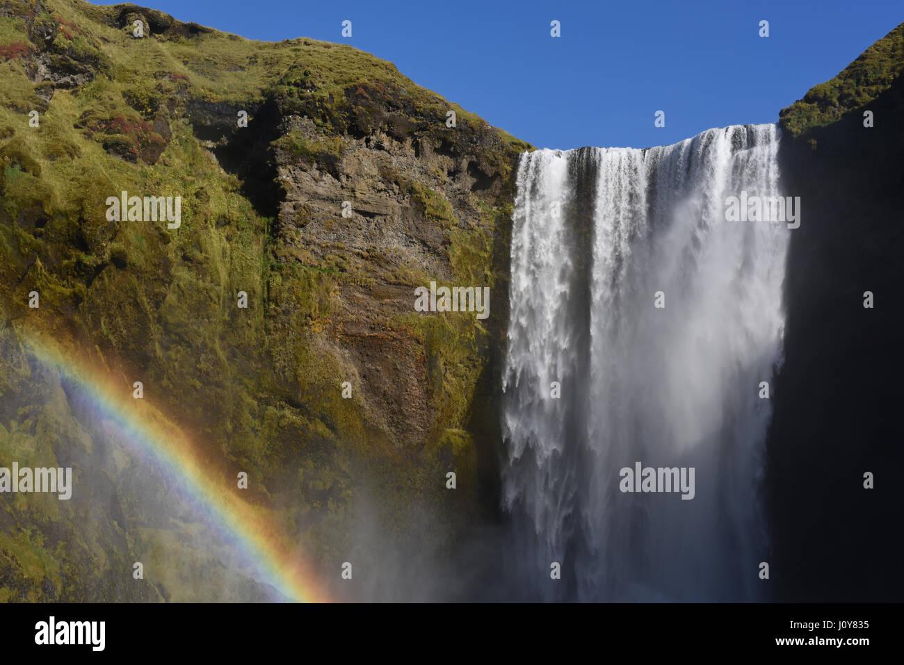 Skogafoss Waterfall and rainbow, Skogar, South Iceland - Stock Image