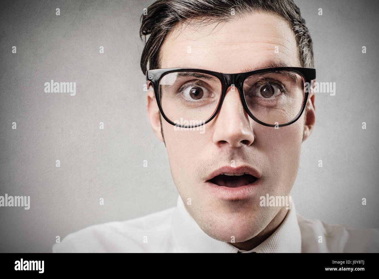 Portrait of surprised businessman - Stock Image