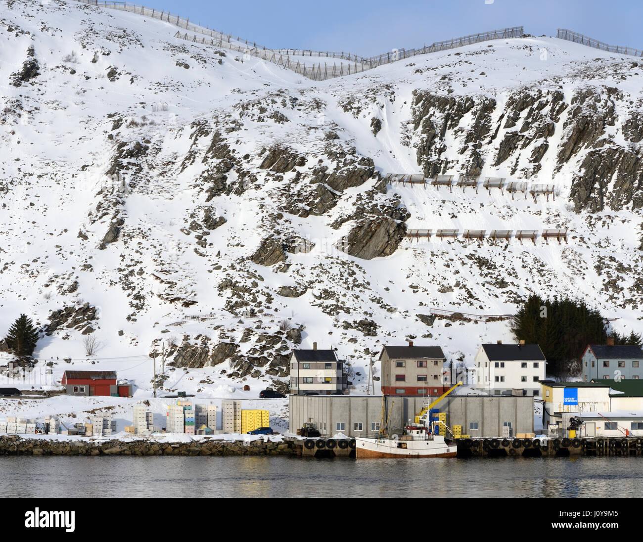 Snow fences for  avalanche control on hills above the harbour of the village of Kjøllefjord.  Kjøllefjord, - Stock Image