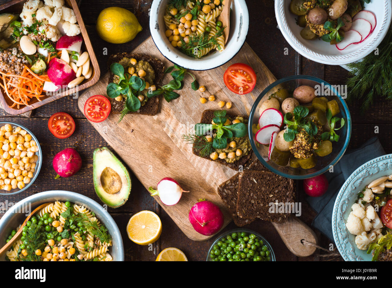 Feast with various salads and sandwiches horizontal - Stock Image