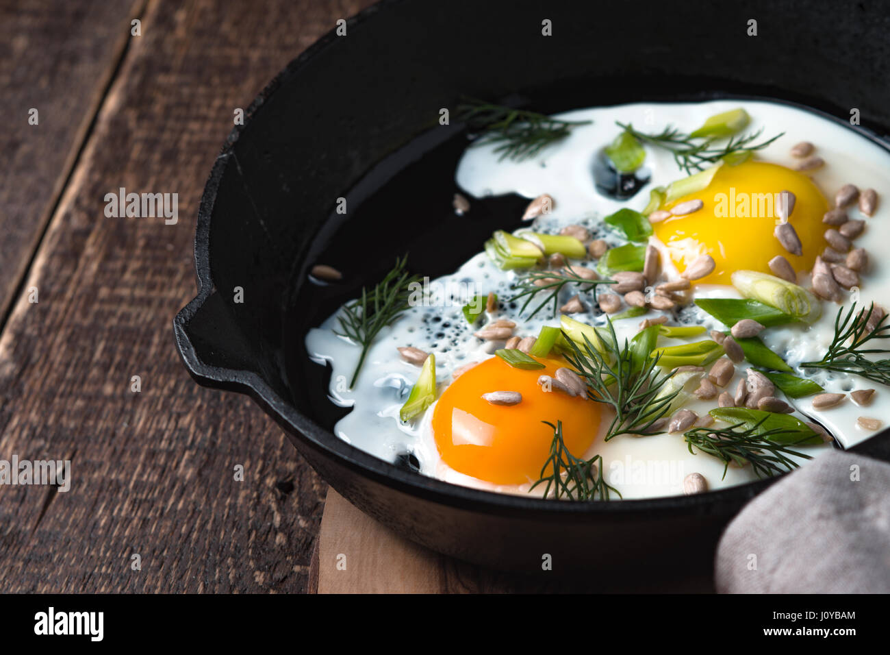 Scrambled eggs  on the wooden table horizontal - Stock Image