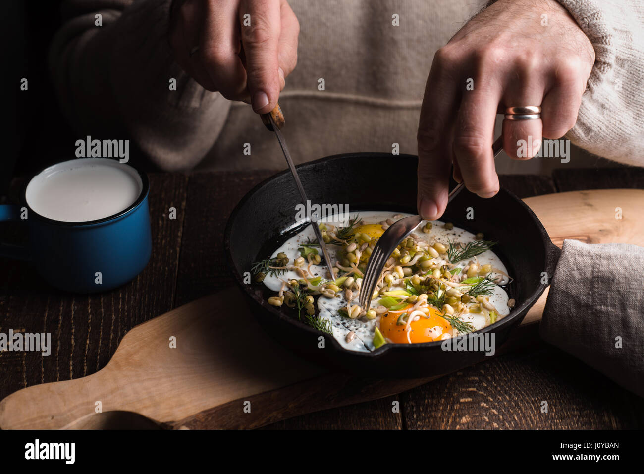 Eating scramble eggs on the wooden table horizontal Stock Photo