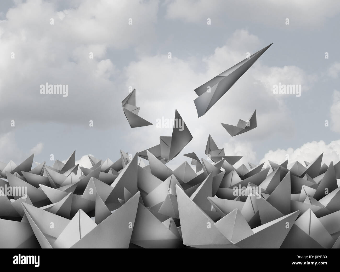 Innovation and opportunity concept as a paper airplane breaking out from a group of origami boats as a business - Stock Image