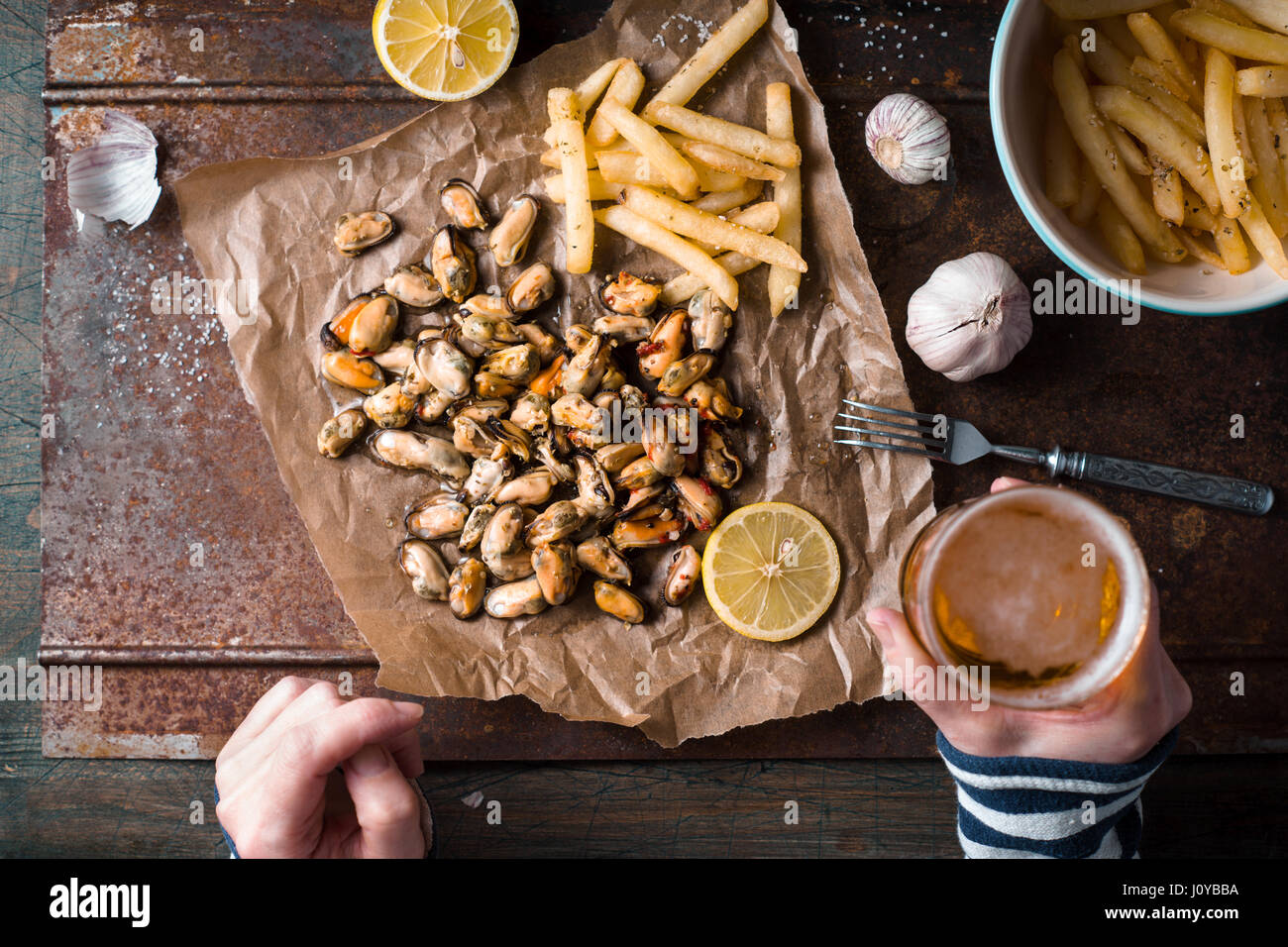 Drinking beer with mussels and French fries top view - Stock Image